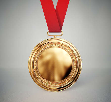 gold medal isolated on a grey background Imagens