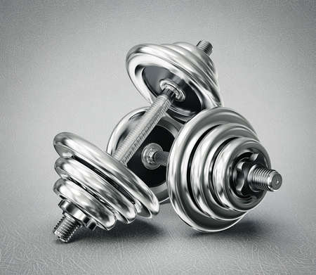 steel dumbbells isolated on a grey background