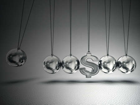 conceptual  balancing balls with dollar sign isolated on a grey photo