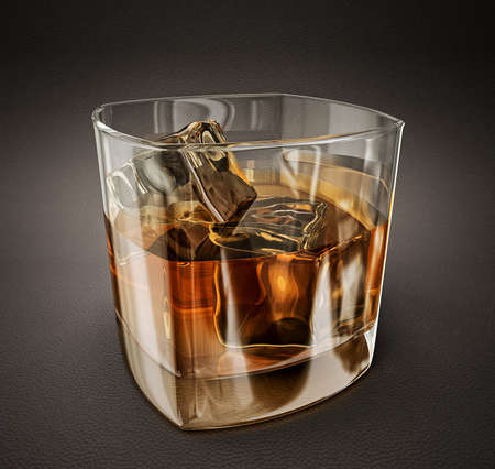 whiskey in glass isolated on a grey background photo