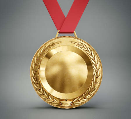 gold medal isolated on a grey background Фото со стока