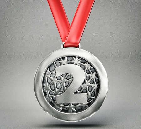 灰色の背景に分離された銀メダル