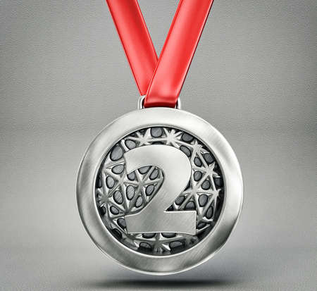 silver medal: silver medal isolated on a grey backround Stock Photo