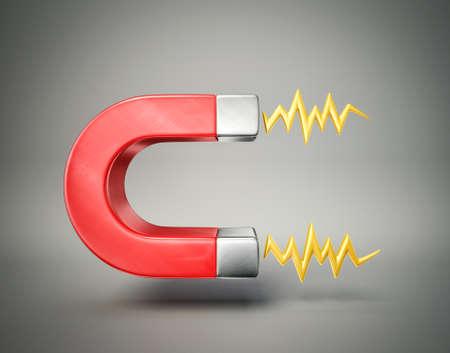 magnetismo: magnete rosso isolato su uno sfondo grigio Archivio Fotografico
