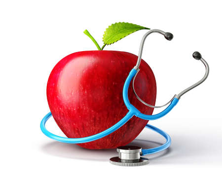 concept red apple with stethoscope on white Foto de archivo