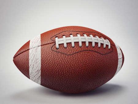 college footbal: bal�n de f�tbol aislado en un fondo gris Foto de archivo