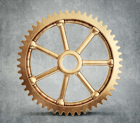 golde: gold gear isolated on a grey background Stock Photo