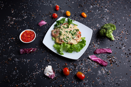 on black background with red tomatoes, bread, red green peppers and broccoli, top view Reklamní fotografie - 124866857