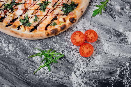 Italian Pizza Restaurant Menu - Classic, decorated with sliced tomatoes and mushrooms,  black background with flour, Top view. Banner, close-up, copy space Reklamní fotografie - 124866992