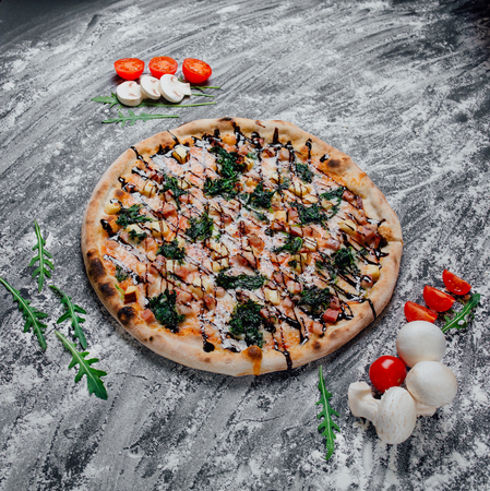 Pizza with Mozzarella cheese, Tomatoes, pepper, Spices and Fresh Basil. Italian pizza, decorated with sliced tomatoes and mushrooms,  black background with flour, Top view. Banner, close-up, copy space