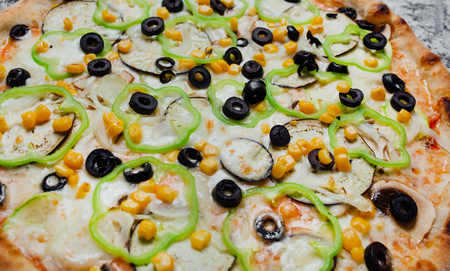 Pizza with mushrooms black olives onions green pepper, black background with flour, sliced peppers, Top view. Banner, close-up, copy space Reklamní fotografie - 124867028