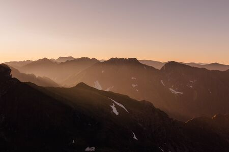 sunrise over the Fagaras Mountains, Romania. View from moldovanul Peak 2544m Stok Fotoğraf