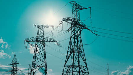 High voltage post. High voltage tower sky background. High-voltage power lines. Energy industry. Production, distribution and transmission of electricity.
