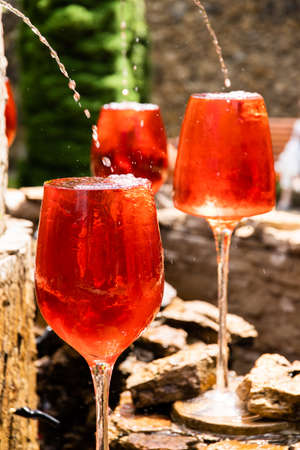 large red glasses fountain decoration. many large glasses of champagne that are for decoration.