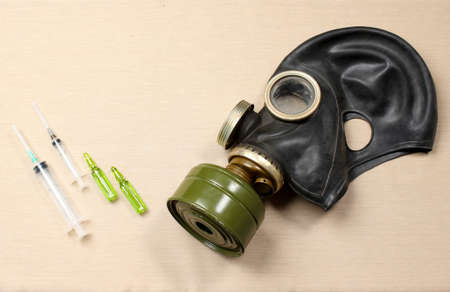 Gas mask and antidote Stock Photo