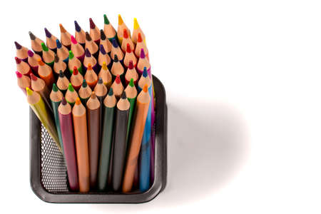 Colored pencils is in a basket isolated