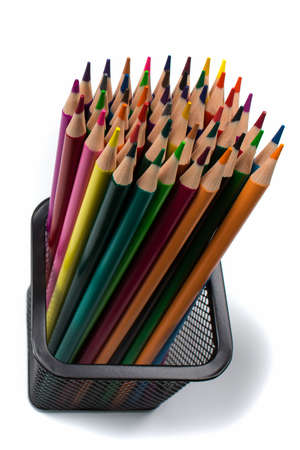 Colored pencils in a box isolated vertical