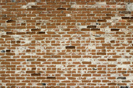 Old brick wall with white seams