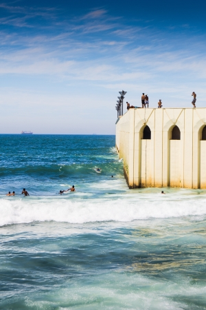 People plunges into the sea Stock Photo