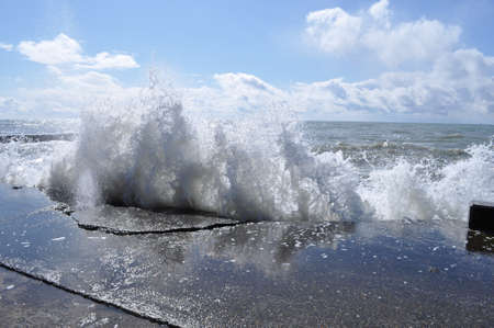 Sea waves breaking on concrete port  Stock Photo - 13522020