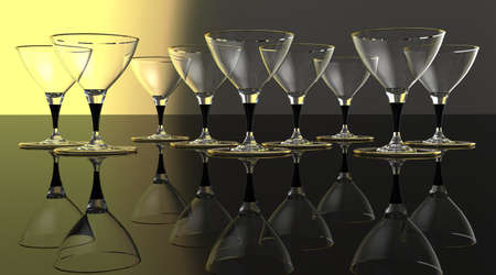 Wine  glasses with gold on plain background with reflective floor.