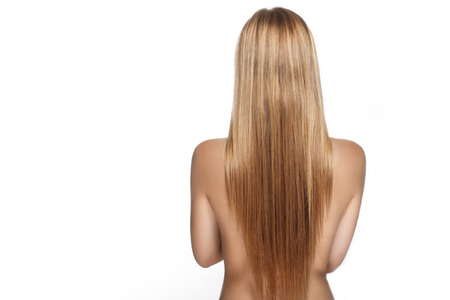 long hair on the back of a beautiful girl on a white background in studio Stock Photo