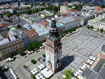 Aerial photo from drone. The culture and historical capital of Poland. Comfortable and beautiful Krakow. The land of Legend. Old part of town,Main square, St. Mary's Basilica.