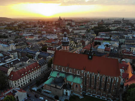 Aerial photo from drone. The culture and historical capital of Poland. Comfortable and beautiful Krakow. The land of Legend. Beautiful Sunset,old part of city.