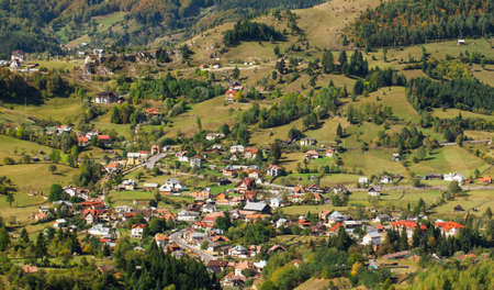 Pretty village in the Carpathian Mountains situated in a valley Stock Photo - 17350930