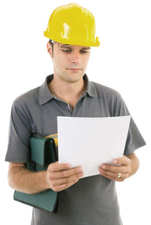 Young engineer with hardhat studying the project Stock Photo - 17345047
