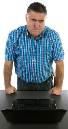 Angry manager in front of his laptop Stock Photo - 17367950
