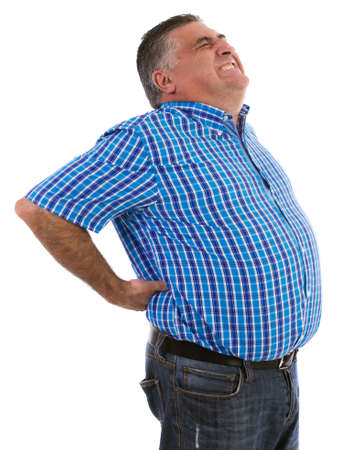 man in pain: Man with a big back pain massage with both hands while enduring overwhelming pain Stock Photo
