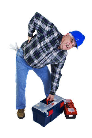 dorsalgia: Workman with backache lifting the toolbox
