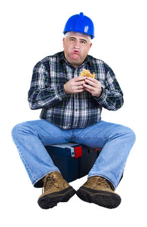 Worker with a mouthful of hamburger on white background photo