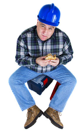 Happy worker eating his hamburger and looking up  White background photo