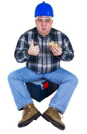 Happy worker enjoying his hamburger sitting in the toolbox photo