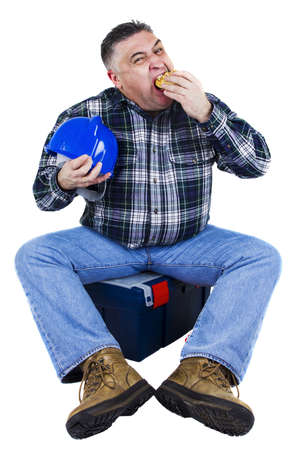 A worker ends his hamburger holding his helmet. White background photo