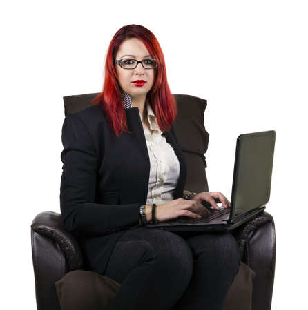 Serious business woman with laptop.  photo