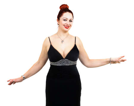 Overweight woman with elegant dress, hands around the body and red hair photo