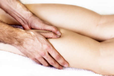 at ease: Physiotherapist massaging finger muscle to ease the pain Stock Photo