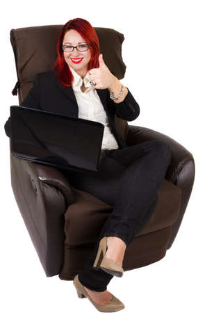 fatness: Businesswoman with laptop and thumb up sitting on the couch. White background