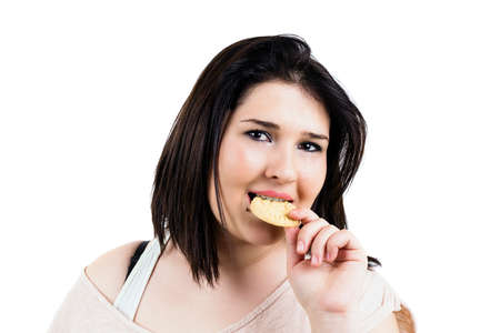 gastronome: Gourmand young woman portrait, eating a cookie, dark hair, close up, isolated on white, studio shoot.