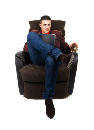 android tablet: Business man with pad and whiskey sitting on the couch. White background
