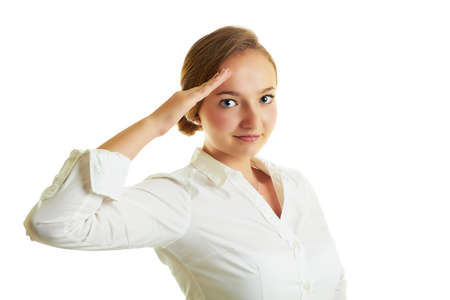Young blonde girl with a beautiful smile saluting as military isolated on white.