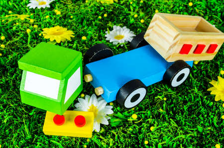 Crushed toy truck on a grass background photo