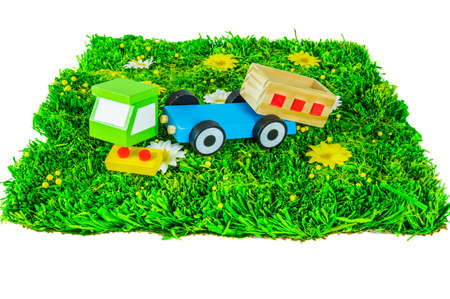 Crushed toy truck on a grass on white background photo