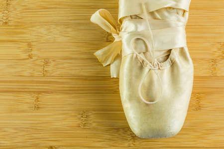ballet slipper: Ballet shoes on wooden flor