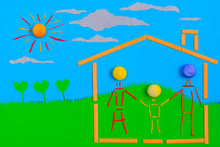figurative: Figurative family, mother, father and children on a house, on a sunny day Stock Photo
