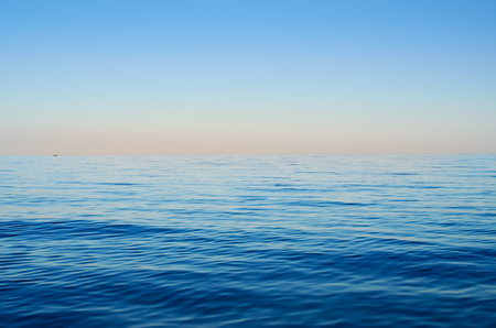 sunrise ocean: Sea waves on a background of blue sky Stock Photo