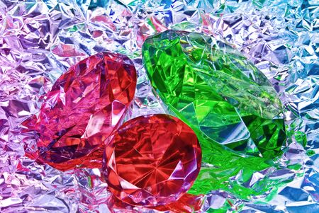 silver jewelry: Precious stones, jewelry on the background of silver foil Stock Photo